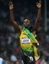 Jamaica's Usain Bolt celebrates after winning the men's 4X100 relay final at the athletics event of the London 2012 Olympic Games on August 11, 2012 in London.  AFP PHOTO / OLIVIER MORIN