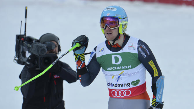 United States's TedLigety reacts after the first run of the men's giant slalom  at the Alpine skiing world championships in Schladming, Austria, Friday, Feb. 15, 2013. (AP Photo/Kerstin Joensson)