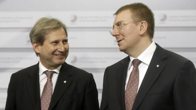 European Neighbourhood Policy and Enlargement Negotiations Commissioner-designate Hahn and Latvia's Minister of Foreign Affairs Rinkevics wear identical ties as they arrive to the informal European Union Ministers of Foreign Affairs meeting in Riga