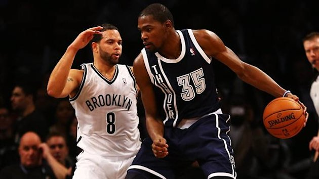 Kevin Durant of the Oklahoma City Thunder dribbles against Deron Williams of the Brooklyn Nets at the Barclays Center (AFP)