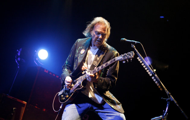 FILE - In this Monday, Dec. 15, 2008, file photo, Neil Young performs at Madison Square Garden in New York. Neil Young said, Sunday, Dec. 2, 2012, he couldn&#39;t see performing in the area devastated by Superstorm Sandy without doing something to help people who were affected by it. Young and his longtime backing band, Crazy Horse, will be near Atlantic City&#39;s devastated boardwalk for a benefit concert Thursday. (AP Photo/Jason DeCrow, File)