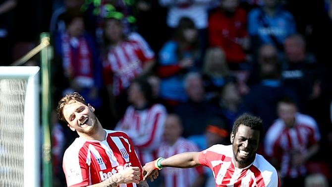 Stoke City's Mame Diouf, right, celebrates scoring his side's first goal of the game against Southampton with teammate Marko Arnautovic during their English Premier League soccer match at the Britannia Stadium, Stoke On Trent, England, Saturday, April 18, 2015. (Lynne Cameron/PA via AP)     UNITED KINGDOM OUT      -     NO SALES     -    NO ARCHIVES