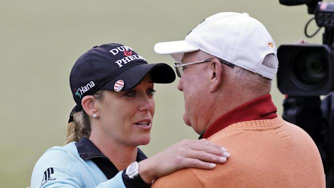 Cristie Kerr gets a hug from her father Michael Kerr as she celebrates winning the Kingsmill Championship LPGA golf tournament in Williamsburg, Va., Sunday, May 5, 2013. Kerr made a short par putt on the second hole of a sudden-death playoff with Suzann Pettersen for the victory. (AP Photo/Steve Helber)