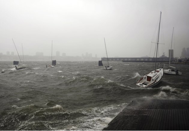 Sailboats rock in choppy water at a dock along the Hudson River Greenway during a storm, Monday, Oct. 29, 2012, in New York. Hurricane Sandy continued on its path Monday, forcing the shutdown of mass