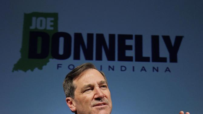 "Democrat Joe Donnelly thanks supporters after winning the U.S. Senate seat over Republican Richard Mourdock at an election night celebration in Indianapolis, Tuesday, Nov. 6, 2012. Donnelly triumphed in one of the nation's most tumultuous Senate races, capitalizing on fallout over his tea party-backed opponent's comment that a pregnancy resulting from rape is ""something God intended"" to capture a seat that just a year ago looked to be a lock for Republican U.S. Sen. Richard Lugar. (AP Photo/Michael Conroy)"