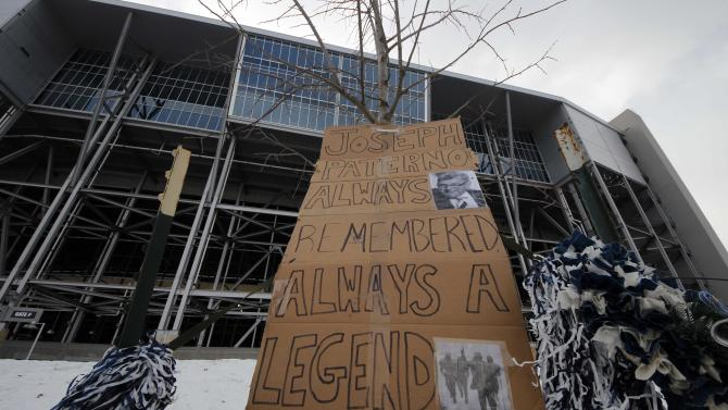 A sign of support is displayed near the site where a bronze statue of former Penn State head coach Joe Paterno once stood outside Beaver Stadium in State College, Pa., Tuesday, Jan. 22, 2013. Supporters of Paterno are marking the 1-year anniversary of his death with a candlelight vigil Tuesday night.  (AP Photo/Gene J. Puskar)