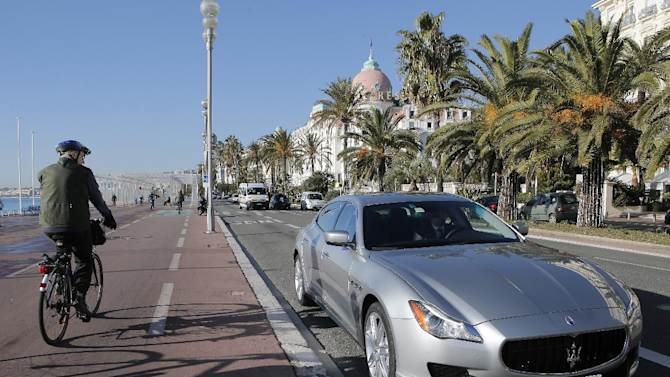 """The new Maserati Quattroporte is displayed on """"la Promenade des Anglais"""" in Nice, southern France, during a presentation to the media, Monday, Dec. 10, 2012. The new sixth-generation Maserati Quattroporte is a luxury four-door saloon made by Maserati in Italy and will be shown at the Detroit motor show in January 2013, production started in November 2012. (AP Photo/Lionel Cironneau)"""
