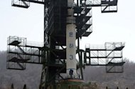 The Unha-3 rocket is docked at the Tangachai-ri space center on April 8. The UN Security Council on Monday tightened sanctions on North Korea over its failed rocket launch and warned of new action if the isolated state stages a new nuclear test