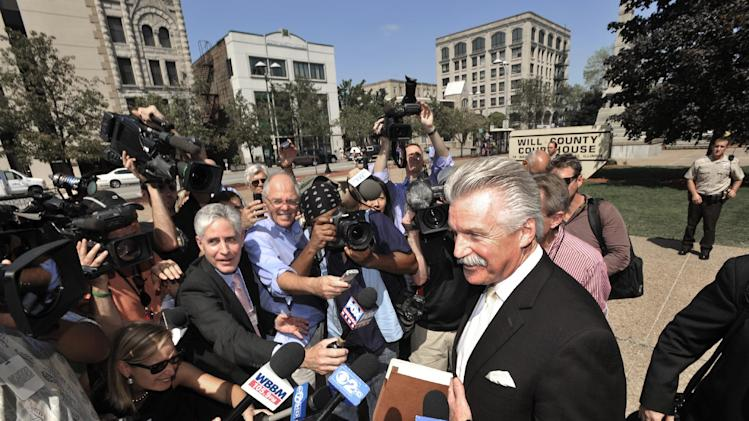 Will County State's Attorney James Glasgow speaks to the media outside the Will County Courthouse after the second day of the murder trial of Drew Peterson, Wednesday, Aug. 1, 2012 in Joliet, Ill.. Peterson, 58, is charged with killing his third wife, Kathleen Savio, in 2004. Her body was found in a dry bathtub in her home, her hair soaked with blood. He is also a suspect in the 2007 disappearance of his fourth wife, Stacy Peterson. (AP Photo/Paul Beaty)