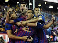Barcelona&#39;s forward Pedro Rodriguez (C) celebrates with his teammates after scoring during the Spanish King&#39;s Cup final against Athletic Bilbao at the Vicente Calderon stadium in Madrid. Barcelona won 3-0