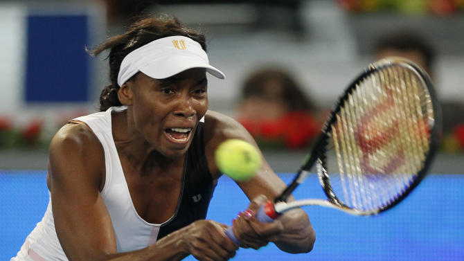 Venus Williams returns the ball during the Madrid Open tennis tournament against Simona Halep from Romania in Madrid, Saturday, May 5, 2012. (AP Photo/Andres Kudacki)
