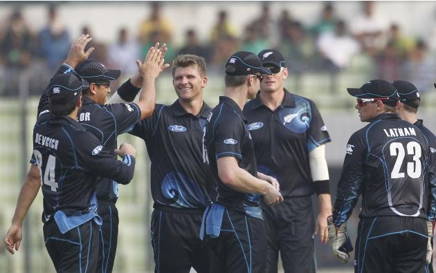 New Zealand's fielders congratulate Corey Anderson after he dismissed Bangladesh's Mominul Haque successfully during their second one-day international (ODI) cricket match in Dhaka.