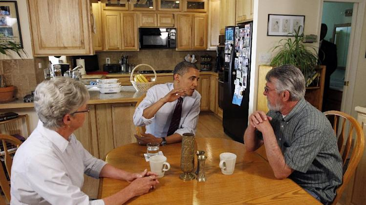 FILE - In this Friday, May 11, 2012 file photo, President Barack Obama meets with Val and Paul Keller in their home in Reno, Nev. Obama and his Republican rival, Mitt Romney, have visited the state, competing strenuously for Nevada's six electoral votes in what has become one of the most intense swing-state contests. (AP Photo/Pablo Martinez Monsivais, File)