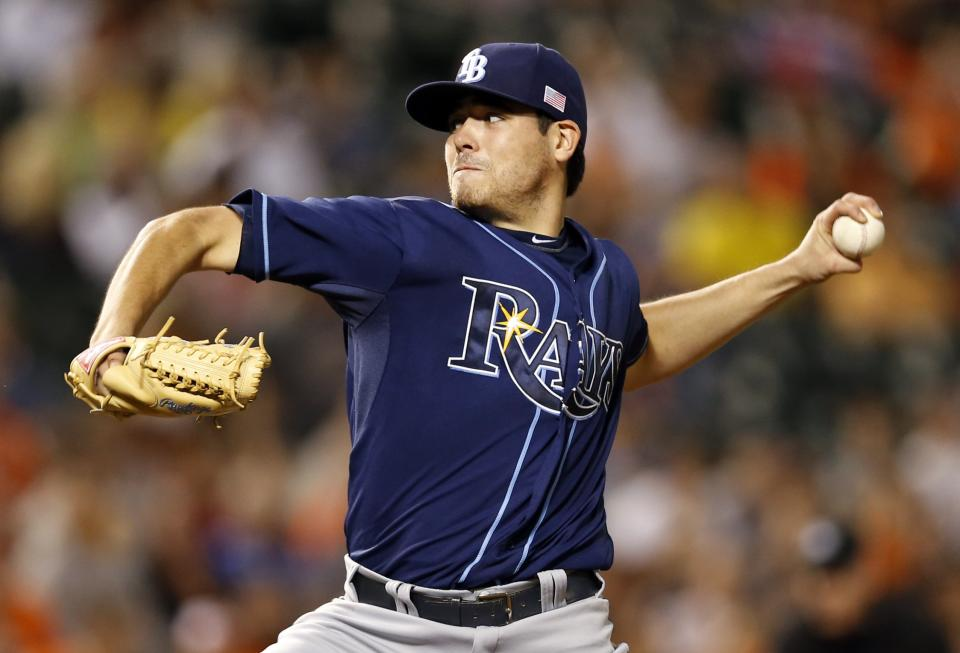 Tampa Bay Rays starting pitcher Matt Moore throws to the Baltimore Orioles in the third inning of a baseball game in Baltimore, Tuesday, Sept. 11, 2012. (AP Photo/Patrick Semansky)