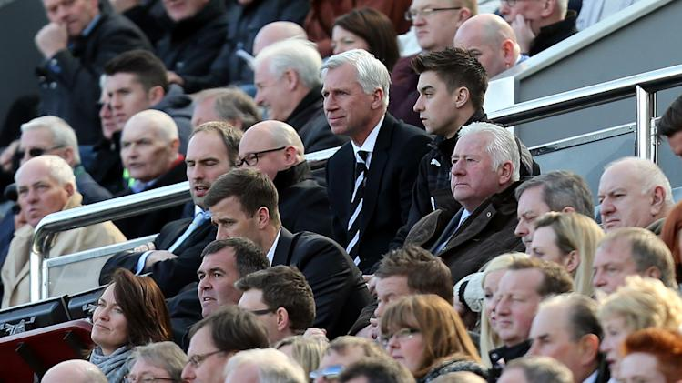 Newcastle United's manager Alan Pardew, center rear, looks on from the stand during their English Premier League soccer match against Swansea City at St James' Park, Newcastle, England, Saturday, April 19, 2014. (AP Photo/Scott Heppell)