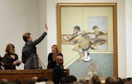 "Francis Bacon's ""Figure Writing Reflected in a Mirror"" is auctioned off at Sotheby's in New York on May 9. The painting brought in $44.9 million at Sotheby's, capping a week of breathtaking sales in the luxury art market"