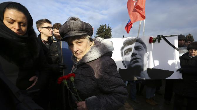 People attend a march to commemorate Kremlin critic Boris Nemtsov, who was shot dead on Friday night, in central St. Petersburg