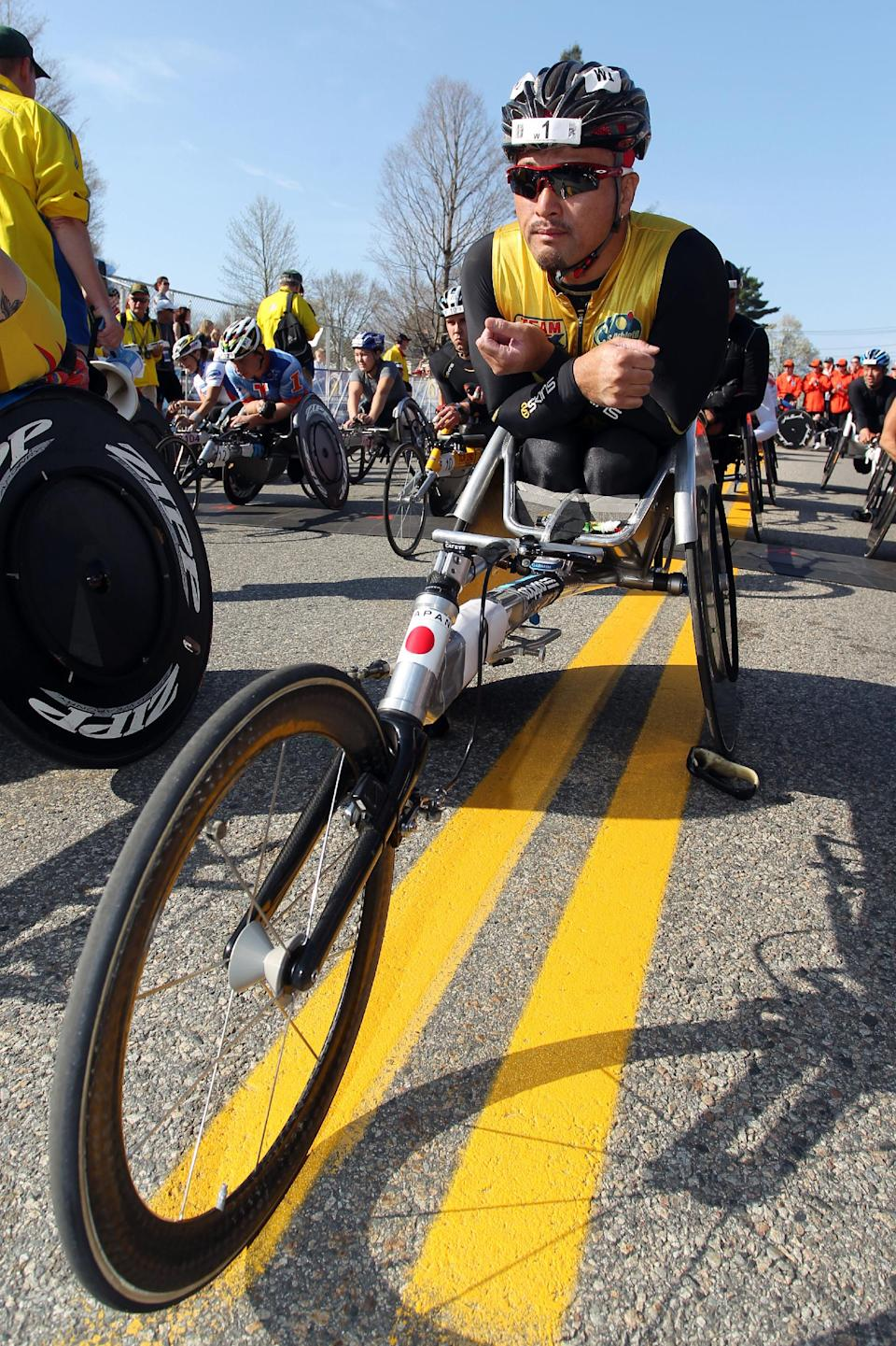 Masazumi Soejima, of Japan, waits for the start of the wheelchair division of 116th running of the Boston Marathon, in Hopkinton, Mass., Monday, April 16, 2012. (AP Photo/Stew Milne)