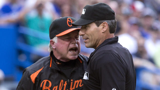 Baltimore Orioles manager Buck Showalter, left, argues a call with home plate umpire Angel Hernandez during the second inning of a baseball game against Toronto Blue Jays in Toronto on Friday, June 21, 2013. (AP Photo/The Canadian Press, Chris Young)
