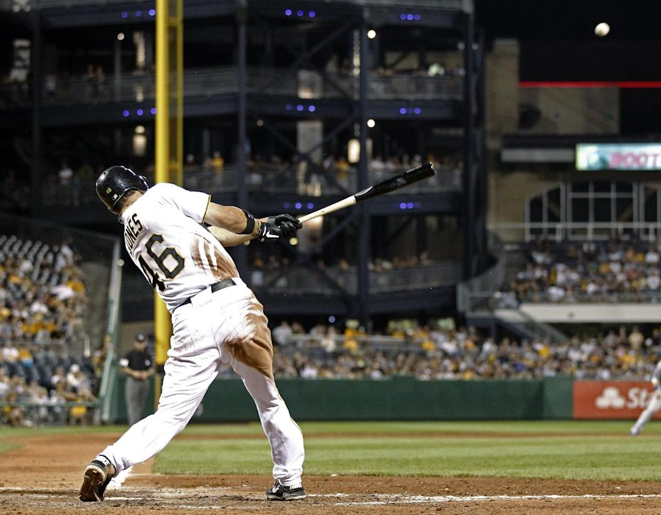 Pittsburgh Pirates' Garrett Jones hits a double in the eighth inning, driving in Andrew McCutchen, during a baseball game against the Los Angeles Dodgers, Monday, Aug. 13, 2012, in Pittsburgh. Jones went 4-for-4, but the Dodgers won 5-4. (AP Photo/Keith Srakocic)