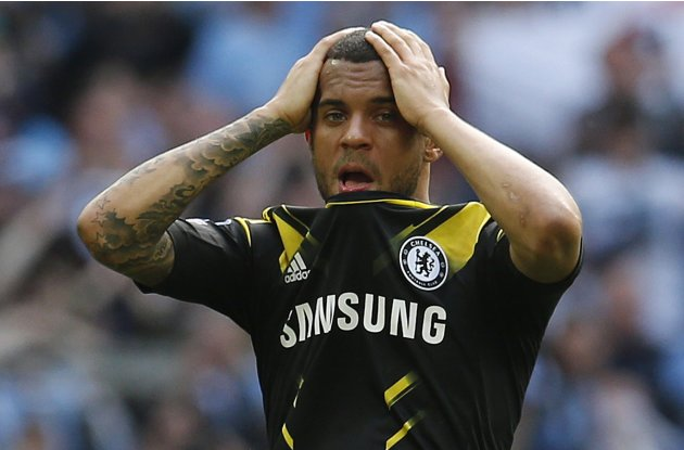 Chelsea's Bertrand reacts at the end of their FA Cup semi-final soccer match against Manchester United at Wembley Stadium in London