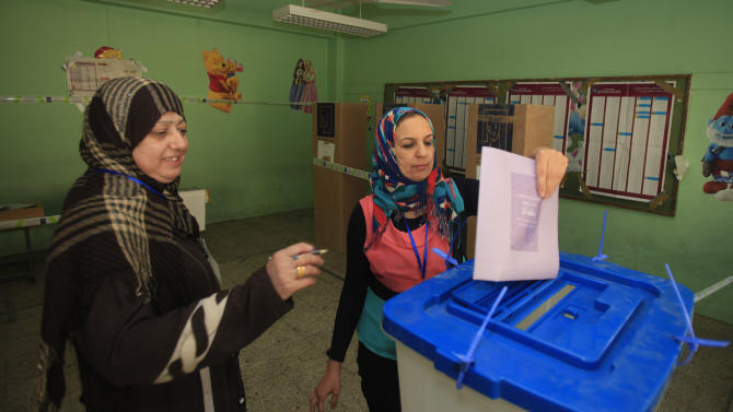 An Iraqi woman casts her ballot at a polling center during the country's provincial elections in Baghdad, Iraq, Saturday, April 20, 2013. Polls opened amid tight security in Iraq on Saturday for regional elections in the country's first vote since the U.S. military withdrawal, marking an important test of the country's stability. (AP Photo/Karim Kadim)
