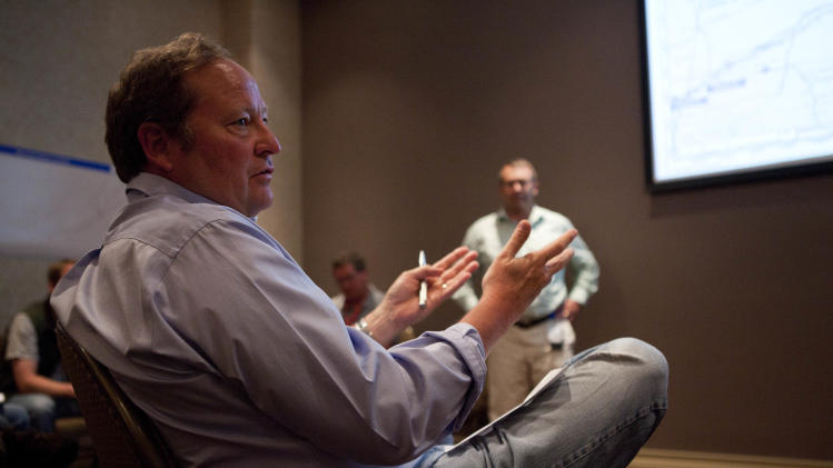 Montana Governor Brian Schweitzer asks questions of ExxonMobil representatives during a briefing about the oil spill in the Yellowstone River, Tuesday July 5, 2011, in Billings, Mont. An ExxonMobil pipeline near Laurel, Mont., ruptured last Friday and spilled an estimated 1,000 barrels of crude into the Yellowstone . (AP Photo/Jim Urquhart)
