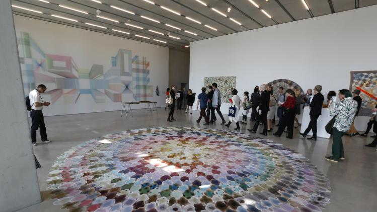 Journalists view artwork during a media tour of the Perez Art Museum Miami (PAMM) in Miami, Florida