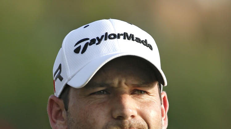 Sergio Garcia, of Spain, reacts after hitting his tee shot on the 18th hole into the water during the final round of The Players Championship golf tournament at Sawgrass, Sunday, May 12, 2013, in Ponte Vedra Beach, Fla. (AP Photo/Chris O'Meara)