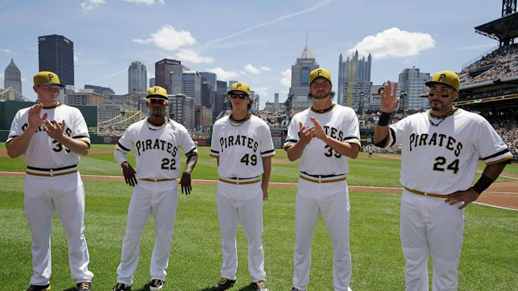 Pittsburgh Pirates All-Stars pose for a photo before a baseball game at PNC Park against the New York Mets in Pittsburgh on Sunday, July 14, 2013. From left relief pitcher Mark Melancon (35), center fielder Andrew McCutchen (22), starting pitcher Jeff Locke (49), relief pitcher Jason Grilli (39), and third baseman Pedro Alvarez (24). AP Photo/Gene J. Puskar)