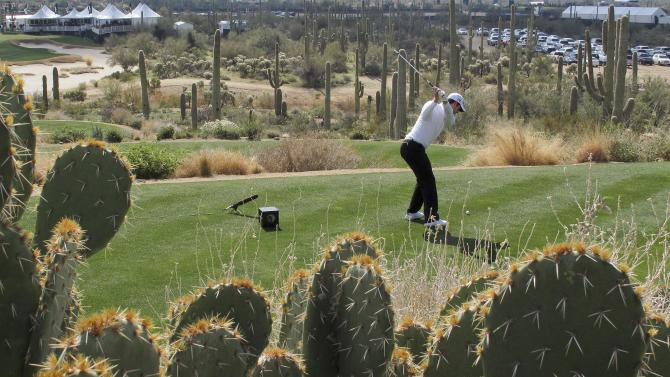 England's Justin Rose tees off the 12th hole against Belgium's Nicolas Cosaerts during the second round of the Match Play Championship golf tournament, Friday, Feb. 22, 2013, in Marana, Ariz. (AP Photo/Ted S. Warren)
