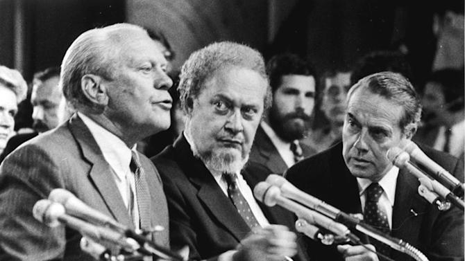 """FILE - In this Sept. 15, 1987 file photo, former President Gerald Ford, left, introduces Supreme Court Associate Justice nominee Robert Bork, as the Senate Judiciary Committee began confirmation hearings on the nomination on Capitol Hill.  Ford praised Bork as being """"uniquely qualified"""" for the post.  At right is Sen. Robert Dole, R-KS, who also made a statement on Bork.  Robert Bork, whose failed Supreme Court nomination made history, has died.  (AP Photo/Charles Tasnadi)"""