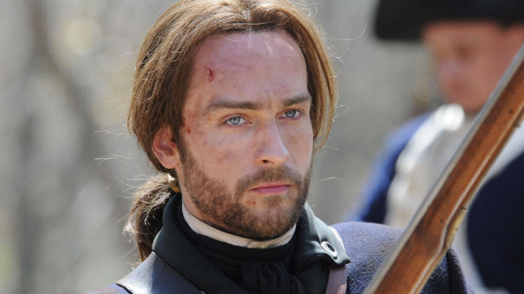 "This publicity photo released by Fox shows Tom Mison in a scene in the new TV action-adventure drama, ""Sleepy Hollow,"" premiering this fall on Fox. (AP Photo/Fox, Brownie Harris)"