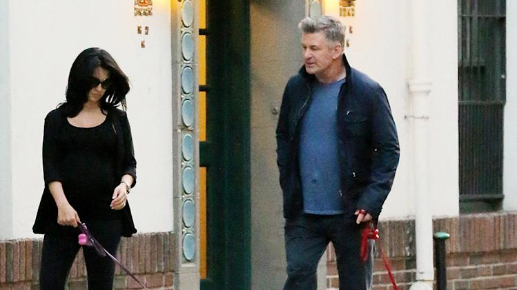Actor Alec Baldwin and his pregnant wife Hilaria Thomas Baldwin go for a walk with their two dogs, bumping into another family in New York City