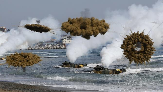 Amphibious assault vehicles of the South Korean Marine Corps throw smoke bombs as they move to land on shore during a U.S.-South Korea joint landing operation drill in Pohang