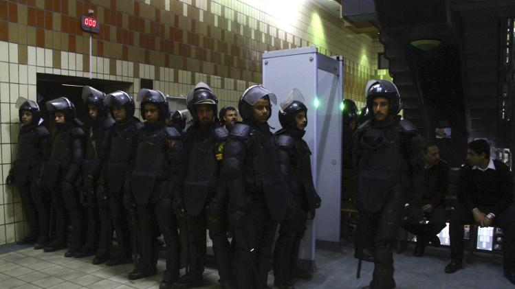 Riot police stand outside a court where an appeal hearing for women, who were found guilty of obstructing traffic during a pro-Islamist protest in October, is held in Alexandria