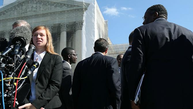 Plaintiff Abigail Fisher (L) speaks to the media after the US Supreme Court heard arguments in her case on October 10, 2012 in Washington, DC