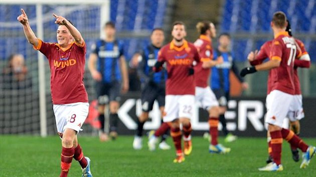 AS Roma midfielder Alessandro Florenzi celebrates scoring during the Italy's Cup semifinal football match AS Roma vs Inter on January 23, 2013