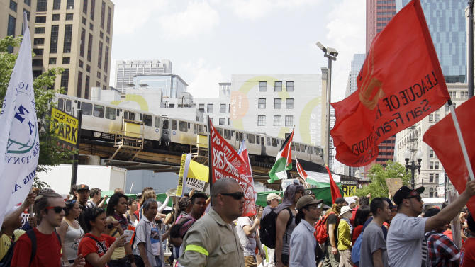 Demonstrators make their way towards Michigan Ave. during a protest march as a part of this weekend's NATO summit in Chicago Sunday, May 20, 2012 in Chicago. (AP Photo/Kim Johnson Flodin)