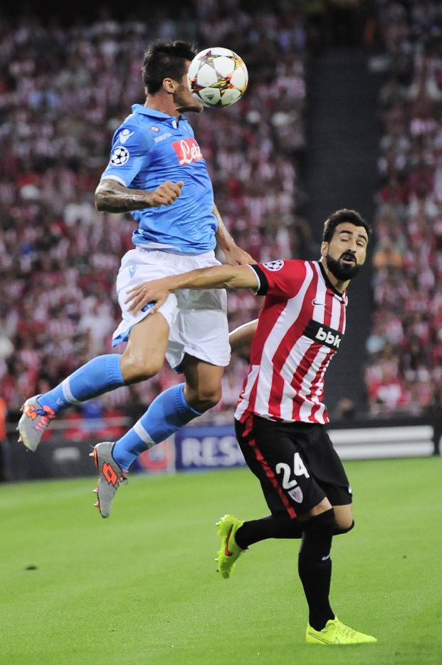 Athletic Bilbao's Mikel Balenziaga, right, duels for the ball in front SSC Napoli's Raul Albiol, during their Champions League playoff second leg soccer match, at San Mames stadium in Bilbao, northern Spain, Wednesday, Aug. 27, 2014