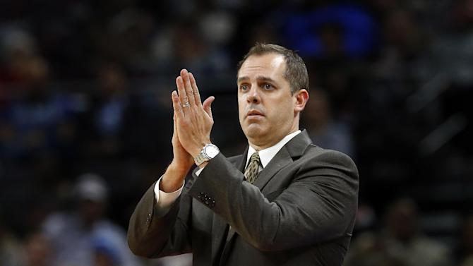 Indiana Pacers head coach Frank Vogel signals in the second half of an NBA basketball game against the Detroit Pistons in Auburn Hills, Mich., Friday, Dec. 26, 2014. (AP Photo/Paul Sancya)