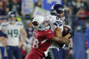 Seattle Seahawks wide receiver Doug Baldwin (89) makes a catch as Arizona Cardinals cornerback Justin Bethel makes the tackle during the first half of an NFL football game, Sunday, Dec. 21, 2014, in Glendale, Ariz. (AP Photo/Rick Scuteri)