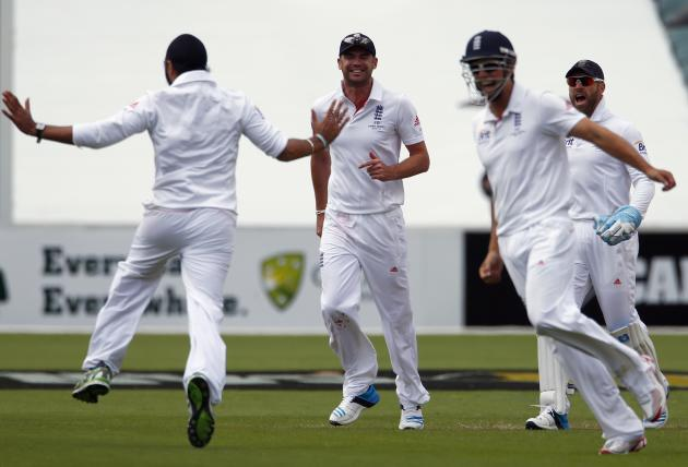 England's Panesar celebrates with team mates Anderson, Cook and Prior after bowling Australia's Smith for six runs during first day's play in the second Ashes cricket test at the Adelaide