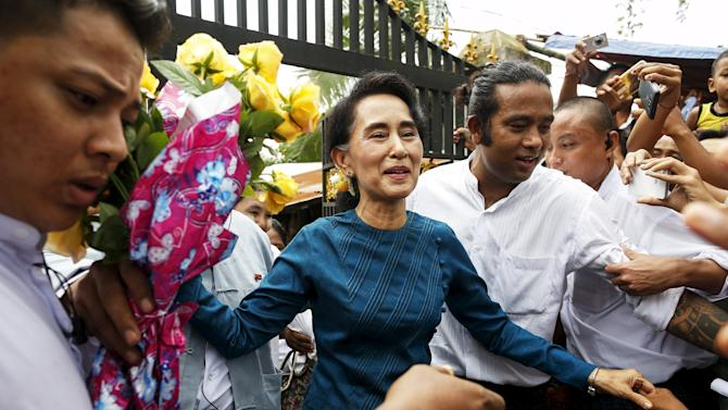 Myanmar pro-democracy leader Aung San Suu Kyi and UNHCR special envoy Angelina Jolie Pitt leave after visiting a hostel for female factory workers in the Hlaingtaryar Industrial Zone in Yangon