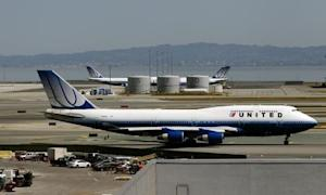 A United Airlines passenger jet taxis to a runway at San Francisco International Airport in San Francisco