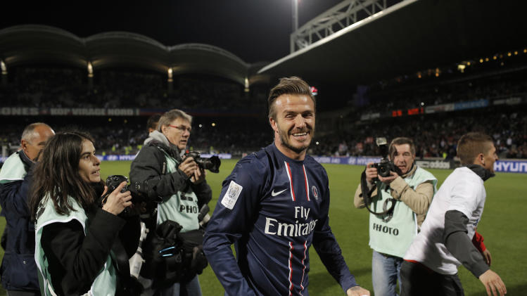Paris Saint Germain's David Beckham celebrates their title after winning their French League One soccer match against Lyon, in Lyon, central France, Sunday, May 12, 2013. (AP Photo/Laurent Cipriani)