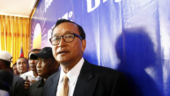 Cambodia National Rescue Party (CNRP) President Sam Rainsy looks on after a press conference in his main party headquarters in Chak Angre Leu in Phnom Penh, Cambodia, Monday, July 29, 2013. Cambodia's opposition party CNRP said Monday it would challenge the results of a general election in which it made impressive gains even though the ruling party of Prime Minister Hun Sen retained power. (AP Photo/Heng Sinith)