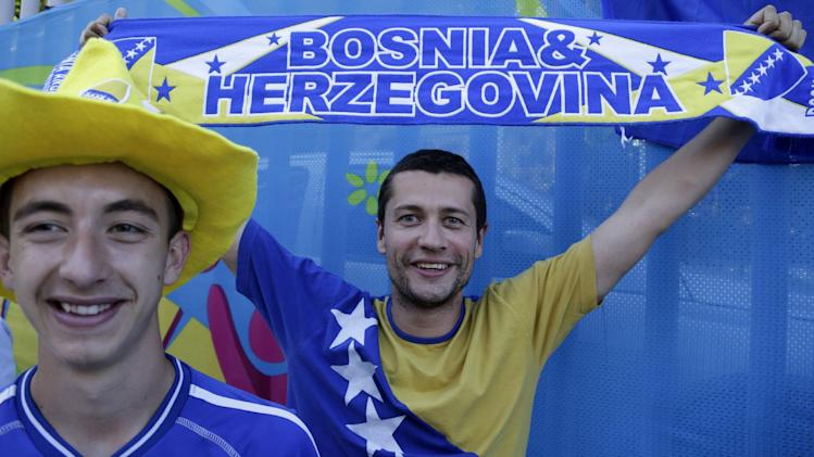Bosnia fans cheer for their national team before the group F World Cup soccer match between Argentina and Bosnia in Rio de Janeiro, Brazil, Sunday, June 15, 2014