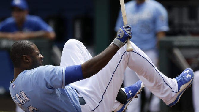 Kansas City Royals Lorenzo Cain (6) hits the ground after being hit by a pitch from Oakland Athletics starting pitcher Scott Kazmir during the first inning of a baseball game at Kauffman Stadium in Kansas City, Mo., Sunday, April 19, 2015. (AP Photo/Orlin Wagner)