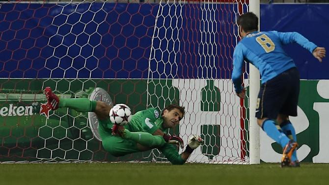 Atletico goalkeeper Daniel Aranzubia, left, saves a penalty from Porto's Josue during a Group G Champions League soccer match between Atletico Madrid and FC Porto at the Vicente Calderon stadium in Madrid, Wednesday Dec. 11, 2013